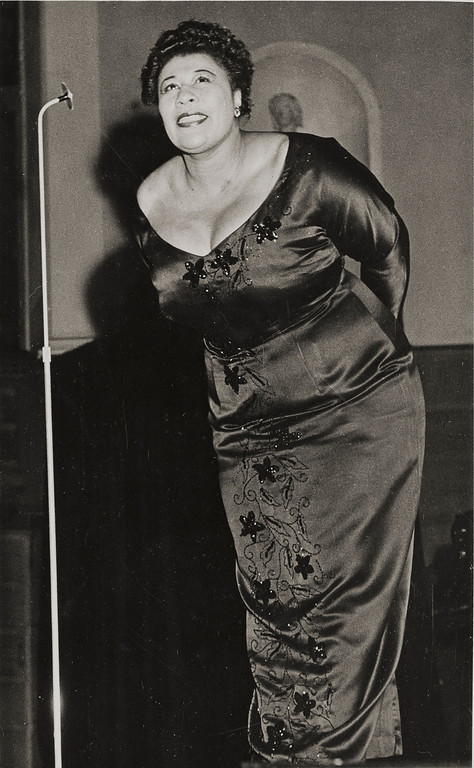""". Ella Jane Fitzgerald (April 25, 1917 � June 15, 1996), also known as the \""""First Lady of Song\"""", \""""Queen of Jazz\"""", and \""""Lady Ella\"""", was an American jazz and song vocalist. Fitzgerald was a notable interpreter of the Great American Songbook. Over the course of her 59-year recording career, she was the winner of 13 Grammy Awards and was awarded the National Medal of Arts by Ronald Reagan and the Presidential Medal of Freedom by George H. W. Bush. Here Ella Fitzgerald performs at a concert in Stockholm, Sweden, Feb. 10, 1952.  (AP Photo)"""