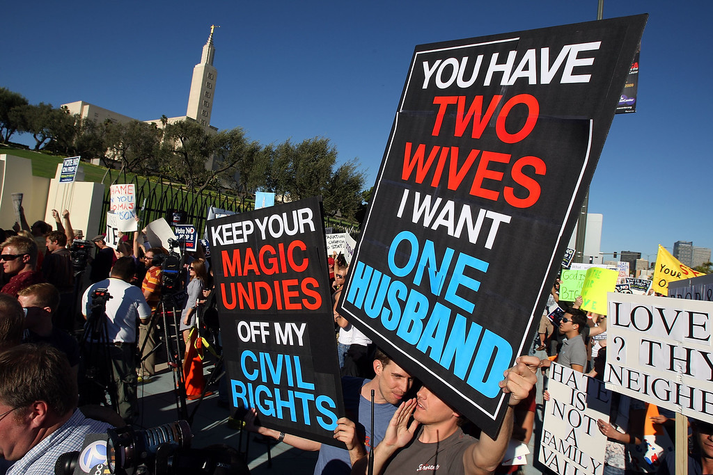 . LOS ANGELES, CA - NOVEMBER 6:  Supporters of same-sex marriage demonstrate near the Los Angeles Mormon Temple, in the distance, before marching for miles in protest against the Church of Jesus Christ of Latter-day Saints November 6, 2008 in Los Angeles, California. The protest, which began outside the Los Angeles Mormon temple, opposes massive financial contributions to the Proposition 8 campaign, which voters passed and which changes the California Constitution to make gay marriage illegal. When same-sex marriages became legal in California on June 16, conservative churches vowed to fight it and successfully passed Proposition 8 with funds that dwarfed that of their opponents. Demonstrators say the Mormon Church contributed some $35 million to pass the measure.  (Photo by David McNew/Getty Images)