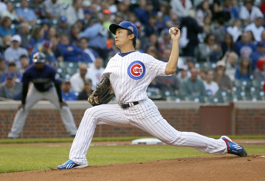 . Chicago Cubs starting pitcher Tsuyoshi Wada delivers during the first inning of a baseball game against the Colorado Rockies Monday, July 28, 2014, in Chicago. (AP Photo/Charles Rex Arbogast)