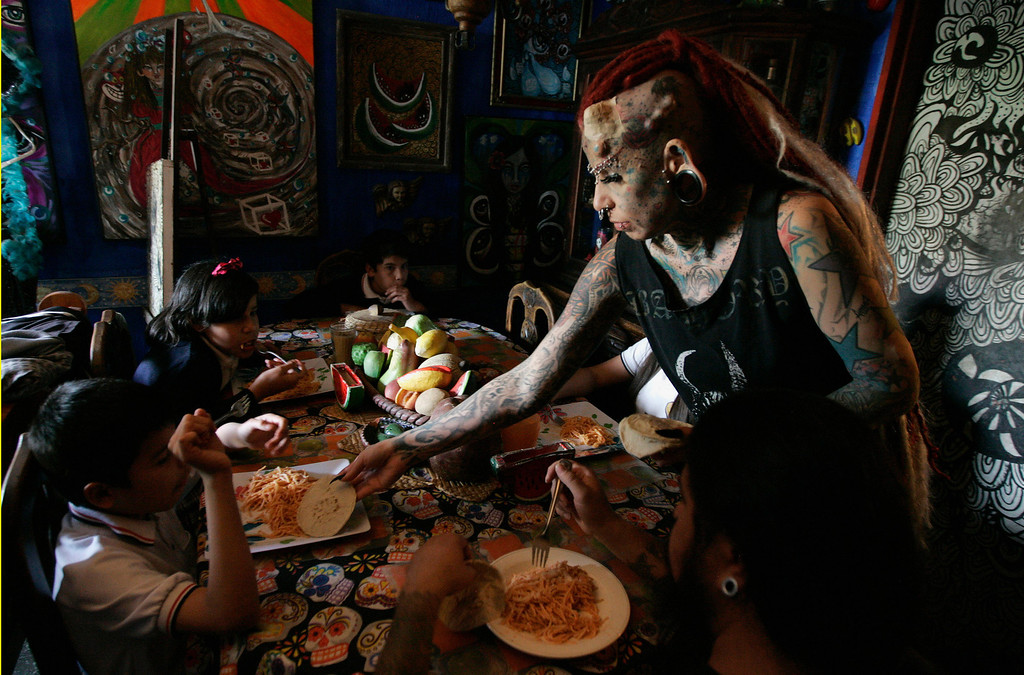 . Maria Jose Cristerna serves lunch to her four children and partner David Pena at their home in Guadalajara February 7, 2012.  REUTERS/Alejandro Acosta (