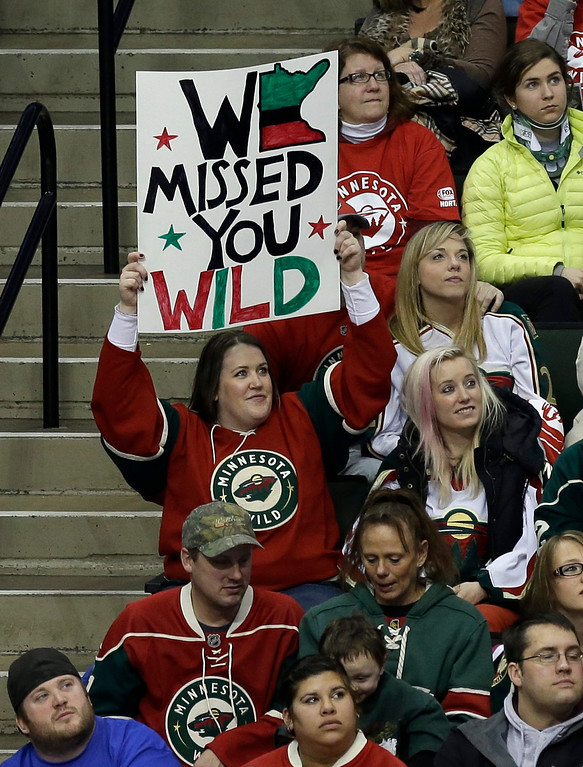 . A Minnesota Wild NHL hockey fan holds up a sign as the Wild hosted the Colorado Avalanche in  an NHL hockey game Saturday, Jan. 19, 2013 in St. Paul, Minn., as the lockout shortened season got underway. (AP Photo/Jim Mone)