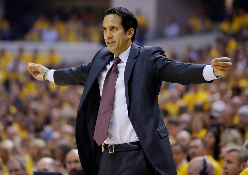 . Miami Heat coach Erik Spoelstra signals to the team during the first half against the Indiana Pacers in Game 5 of the NBA basketball Eastern Conference finals in Indianapolis, Wednesday, May 28, 2014. (AP Photo/Michael Conroy)