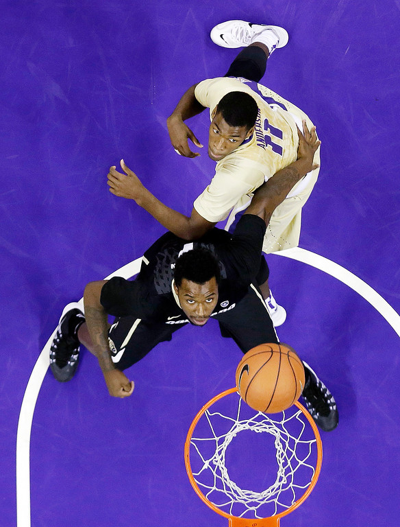 . Colorado\'s Wesley Gordon, bottom, position for a rebound against Washington\'s Mike Anderson in the first half of an NCAA men\'s basketball game Sunday, Jan. 12, 2014, in Seattle. (AP Photo/Elaine Thompson)