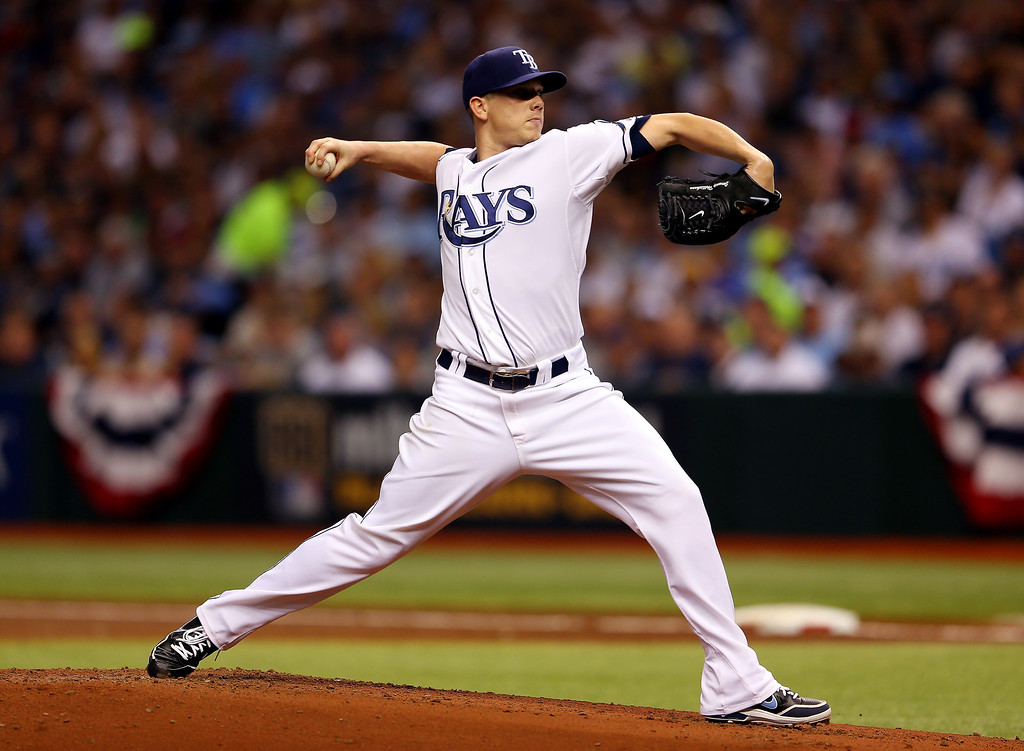 . Jeremy Hellickson #58 of the Tampa Bay Rays pitches against the Boston Red Sox during Game Four of the American League Division Series at Tropicana Field on October 8, 2013 in St Petersburg, Florida.  (Photo by Mike Ehrmann/Getty Images)