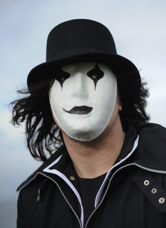 . WHITBY, ENGLAND - NOVEMBER 02: Sam Ash, 26, an architectural metal worker from Nottingham, wears a mime mask as he attends the Goth weekend on November 2, 2013 in Whitby, England. The Whitby Gothic Weekend that takes place in the Yorkshire seaside town twice yearly in Spring and Autumn started in 1994 and sees thousands of extravagantly dressed followers of Victoriana, Steampunk, Cybergoth and Romanticism visit to take part in celebrating Gothic culture.  (Photo by Ian Forsyth/Getty Images)