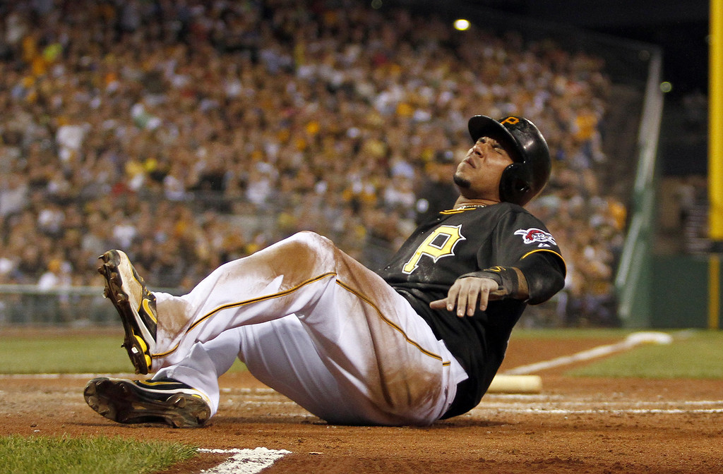 . PITTSBURGH, PA - AUGUST 03:  Jose Tabata #31 of the Pittsburgh Pirates grimaces after scoring on a squeeze in the sixth inning against the Colorado Rockies during the game on August 3, 2013 at PNC Park in Pittsburgh, Pennsylvania.  (Photo by Justin K. Aller/Getty Images)