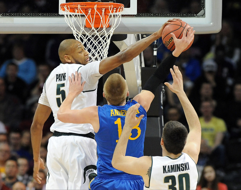 . Adreian Payne #5 of the Michigan State Spartans blocks a shot taken by Kyle Anderson #13 of the Delaware Fightin Blue Hens during the second round of the 2014 NCAA Men\'s Basketball Tournament at Spokane Veterans Memorial Arena on March 20, 2014 in Spokane, Washington.  (Photo by Steve Dykes/Getty Images)