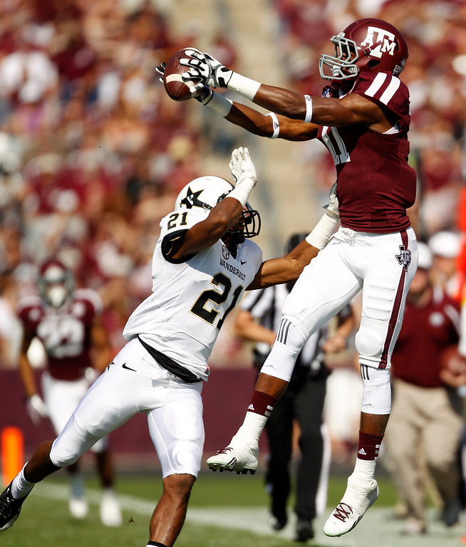 . Texas A&M\'s Derel Walker, right, catches a pass over Vanderbilt\'s Paris Head (21) during the first half of an NCAA football game, Saturday, Oct. 26, 2013, in College Station, Texas. (AP Photo/Eric Christian Smith)