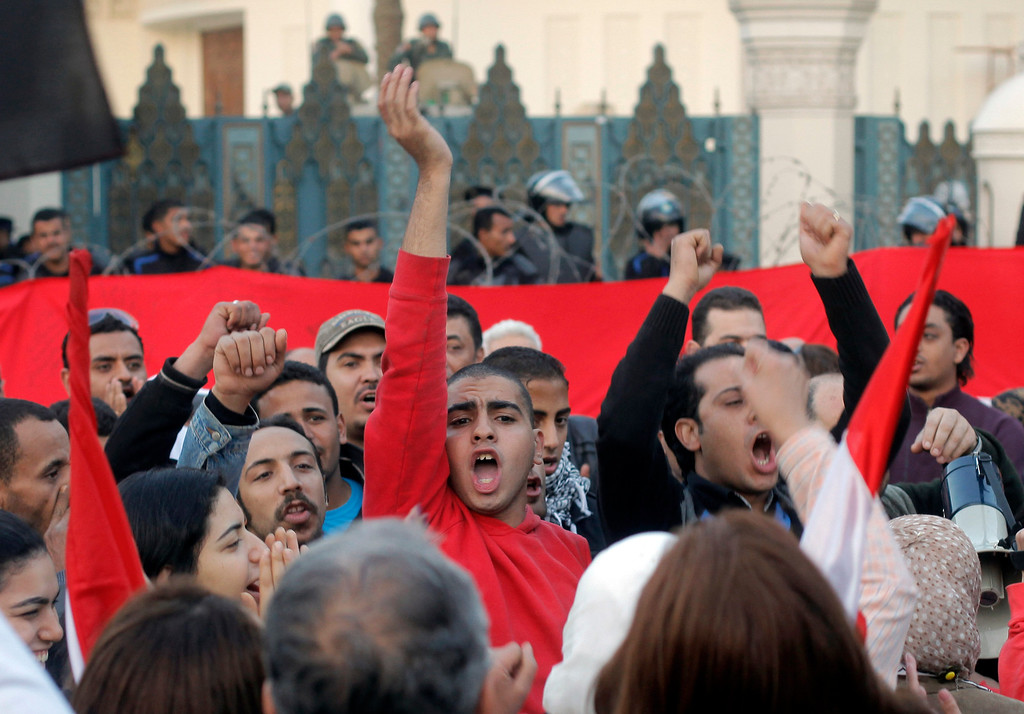 . Egyptian protesters shout slogans against President Mohammed Morsi  in front of the presidential palace in Cairo, Egypt, Friday, Jan.25, 2013. Two years after Egypt\'s revolution began, the country\'s schism was on display Friday as the mainly liberal and secular opposition held rallies saying the goals of the pro-democracy uprising have not been met and denouncing Islamist President Mohammed Morsi. (AP Photo/Amr Nabil)