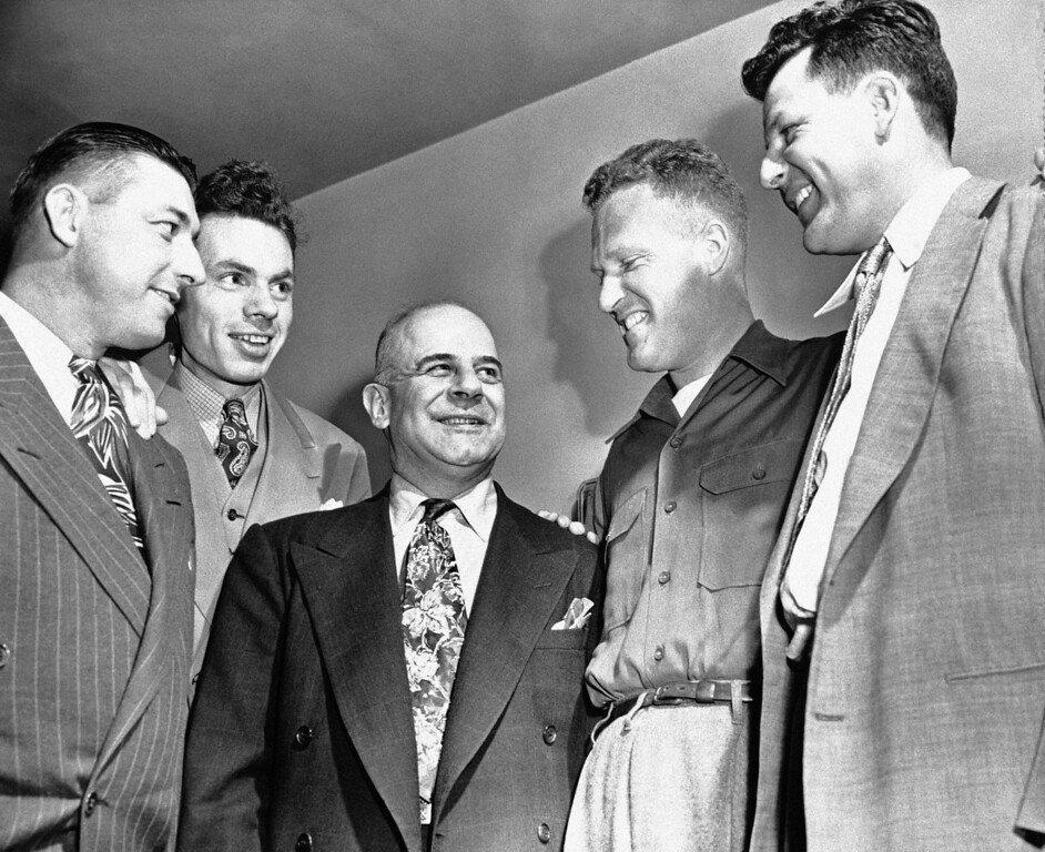 . FILE - In this April 17, 1948 file photo, army fliers greet  James Doolittle, at a raider reunion in Minneapolis. Attending are, from left,  Lt. Fred Braemer, Seattle, Wash., Capt. George Barr, Ashland, Wis., Gen. Doolittle; Maj. Howard Sessler, Los Angeles and Sgt. R. C. Bougeois, New Orleans, La.  Thousands of visitors streamed to the national Air Force museum on Saturday, Nov. 9, 2013 to pay a Veterans Day weekend tribute to the few surviving members of the Doolittle Raiders, airmen whose daring raid on Japan helped boost American morale during World War II, as they planned to make their ceremonial final toast together.  Only four of the 80 Raiders are still living, and one was unable to attend because of health issues.(AP Photo)