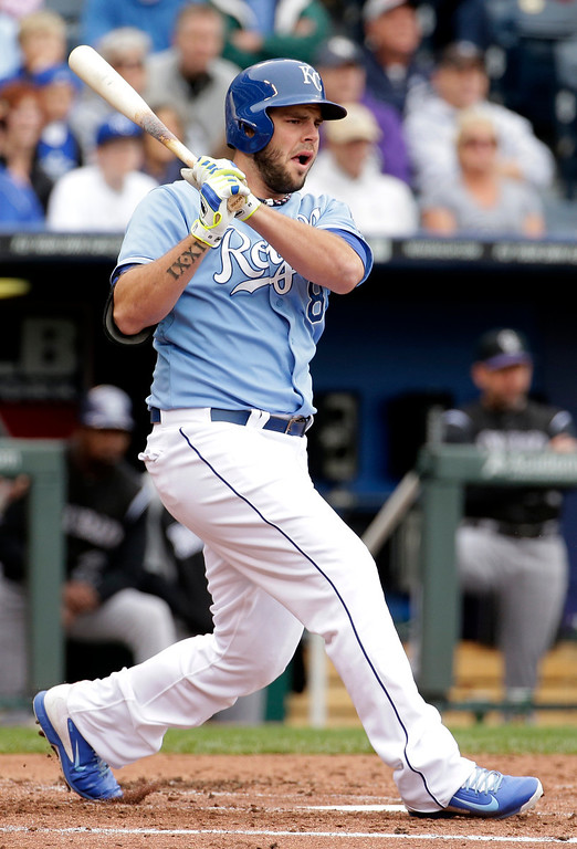 . Kansas City Royals\' Mike Moustakas hits a three-run double during the second inning of a baseball game against the Colorado Rockies Wednesday, May 14, 2014 in Kansas City, Mo. (AP Photo/Charlie Riedel)