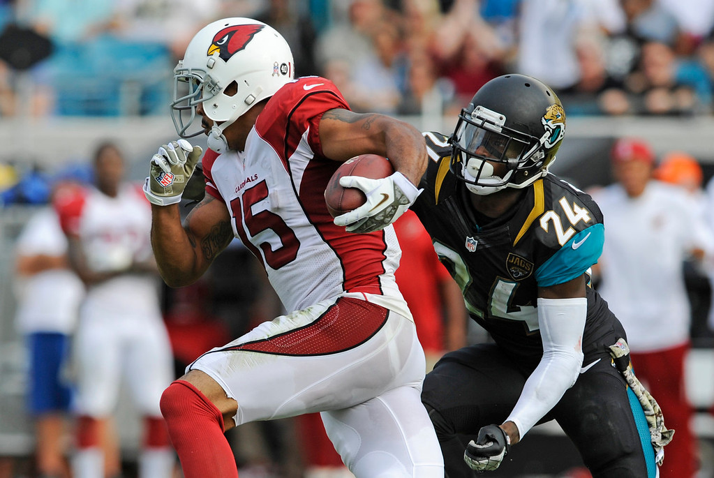 . Arizona Cardinals wide receiver Michael Floyd (15) runs past Jacksonville Jaguars cornerback Will Blackmon (24) for a 91-yard touchdown in the second half of an NFL football game in Jacksonville, Fla., Sunday, Nov. 17, 2013. (AP Photo/Stephen Morton)
