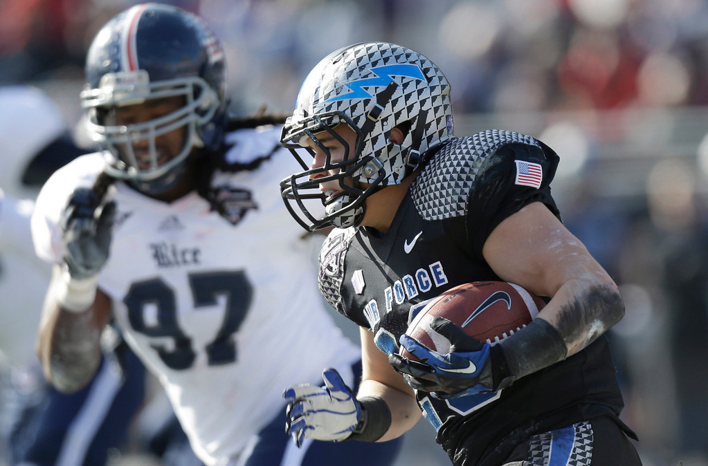 . Air Force running back Cody Getz (28) runs against Rice defensive end Jared Williams (97) during the first half of the Armed Forces Bowl NCAA college football game Saturday, Dec. 29, 2012, in Fort Worth, Texas. (AP Photo/LM Otero)