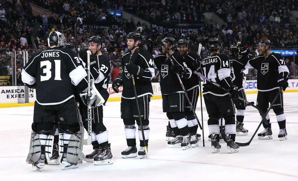 . LOS ANGELES, CA - DECEMBER 21:  Goalie Martin Jones #1 of the Los Angeles Kings is congratulated by his teammates after Jones stopped all three  Colorado Avalanche shots in the shootout at Staples Center on December 21, 2013 in Los Angeles, California.  The Kings won 3-2 on a shootout.  (Photo by Stephen Dunn/Getty Images)