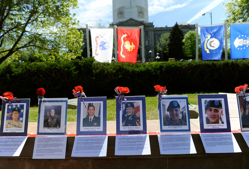 . Photographs of fallen soldiers are on display in Lincoln State Park next to the parade route for the Veterans Memorial Day Tribute. (Photo By Kathryn Scott Osler/The Denver Post)