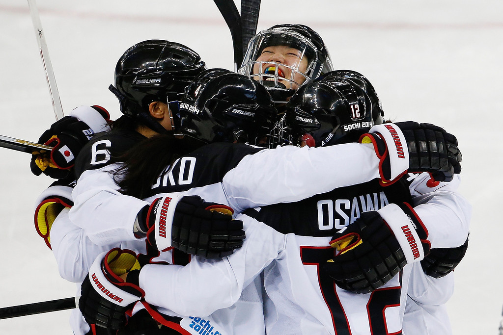 . Team Japan celebrates their second goal against Russia during the 2014 Winter Olympics women\'s ice hockey game at Shayba Arena Sunday, Feb. 16, 2014, in Sochi, Russia. (AP Photo/Petr David Josek)