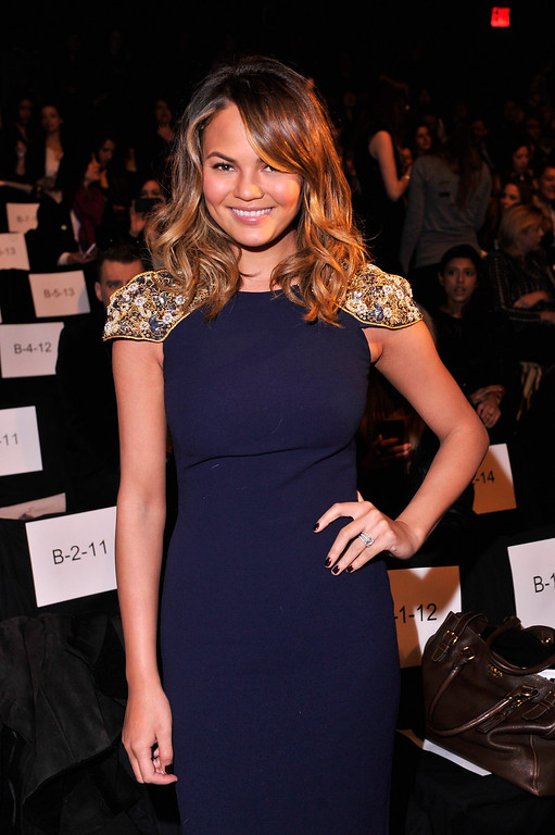. Chrissy Teigen attends the Badgley Mischka fashion show during Mercedes-Benz Fashion Week Fall 2014 at The Theatre at Lincoln Center on February 11, 2014 in New York City.  (Photo by Stephen Lovekin/Getty Images for Mercedes-Benz Fashion Week)