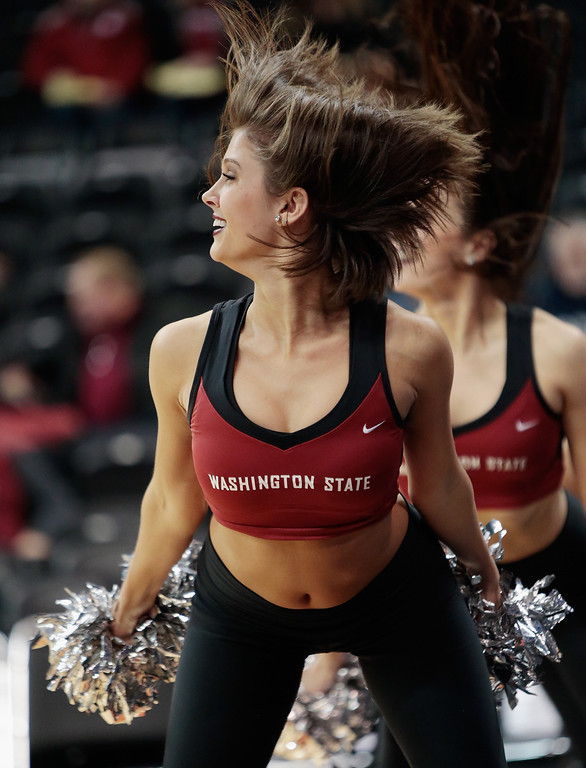 . A member of the Crimson Girls Dance Team for the Washington State Cougars performs during the game against the Colorado Buffaloes at Spokane Arena on January 8, 2014 in Spokane, Washington.  (Photo by William Mancebo/Getty Images)