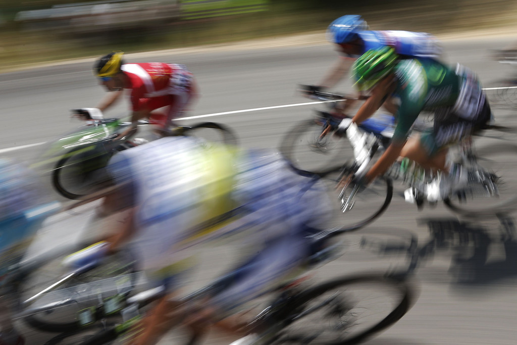 . The pack rides during the 242.5 km fifteenth stage of the 100th edition of the Tour de France cycling race on July 14, 2013 between Givors and Mont Ventoux, southeastern France.    JOEL SAGET/AFP/Getty Images