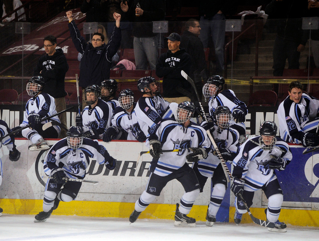 . DENVER, CO. - FEBRUARY 28: Mustangs coach Matt Schoepflin raised his fists in triumph as the team took to the ice to celebrate Friday night. Ralston Valley High School beat Monarch 5-1 Friday night, March 1, 2013 to win the Colorado hockey championship at Magness Arena in Denver. (Photo By Karl Gehring/The Denver Post)