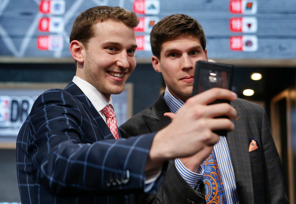 . Michigan\'s Nik Stauskas, left, and Creighton\'s Doug McDermott pose together for a selfie before the start of the 2014 NBA Draft, Thursday, June 26, 2014, in New York. Stauskas was selected eighth overall by the Sacramento Kings. (AP Photo/Kathy Willens)