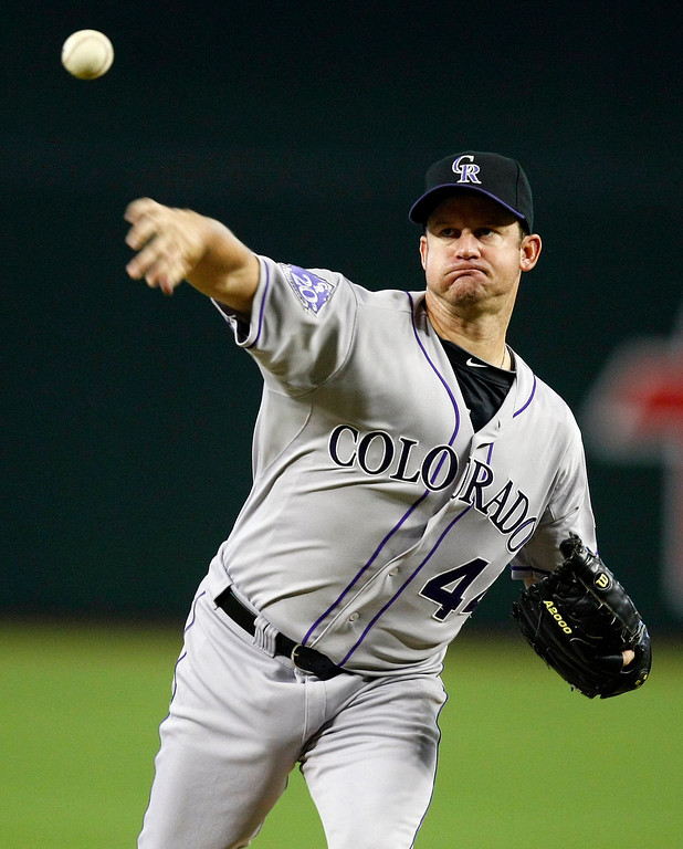 . Colorado Rockies starting pitcher Roy Oswalt  throws in the first inning during a baseball game against the Arizona Diamondbacks on Sunday, July 7, 2013, in Phoenix. (AP Photo/Rick Scuteri)