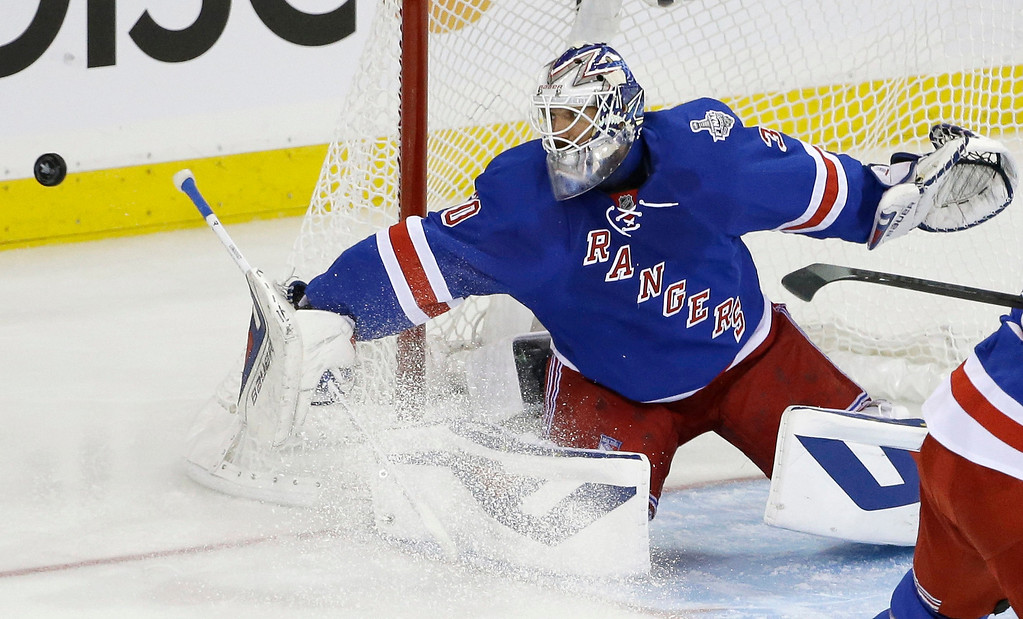 . New York Rangers goalie Henrik Lundqvist (30) blocks a shot by the Los Angeles Kings in the first period during Game 3 of the NHL hockey Stanley Cup Final, Monday, June 9, 2014, in New York. (AP Photo/Frank Franklin II)