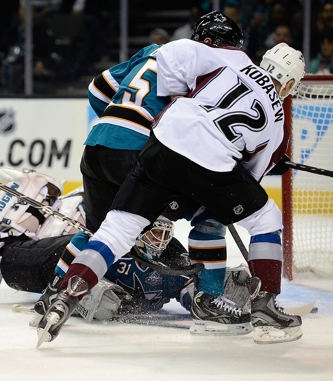 . Chuck Kobasew #12 of the Colorado Avalanche scores a goal getting the rebound shot past Jason Demers #5 and goalkeeper Antti Niemi #31 of the San Jose Sharks in the first period of their NHL Hockey game at HP Pavilion on February 26, 2013 in San Jose, California.  (Photo by Thearon W. Henderson/Getty Images)