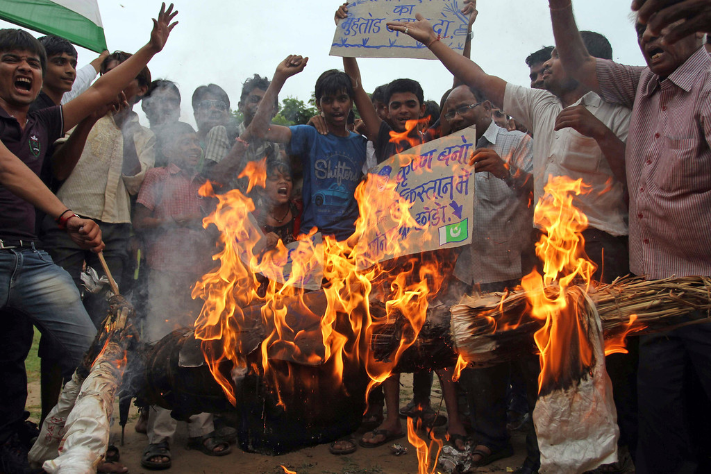 . Indian protesters burn an effigy of Pakistani Prime Minister Nawaz Sharif during a protest in Ahmadabad, India, Saturday, Aug. 10, 2013. India\'s defense minister directly accused Pakistan on Thursday of killing five Indian soldiers in the disputed Himalayan region of Kashmir and suggested it could hurt peace efforts by the two countries. (AP Photo/Ajit Solanki)