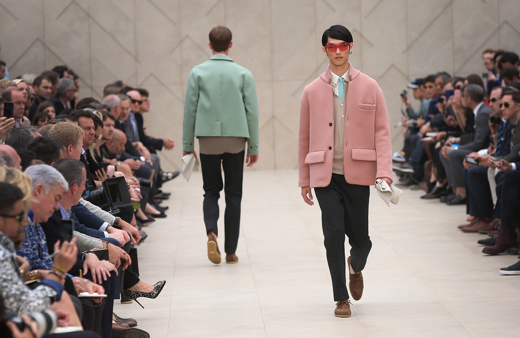 . Models wear creations  for Burberry during London Men\'s spring summer fashion collections 2014, in London, Tuesday, June 18, 2013. (Photo by Joel Ryan/Invision/AP)