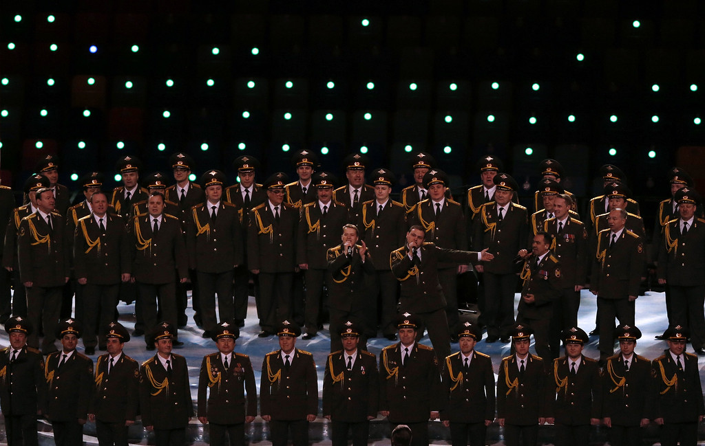 . A military choir performs during the Opening Ceremony of the Sochi Winter Olympics at the Fisht Olympic Stadium on February 7, 2014 in Sochi.  AFP PHOTO / ADRIAN DENNIS/AFP/Getty Images