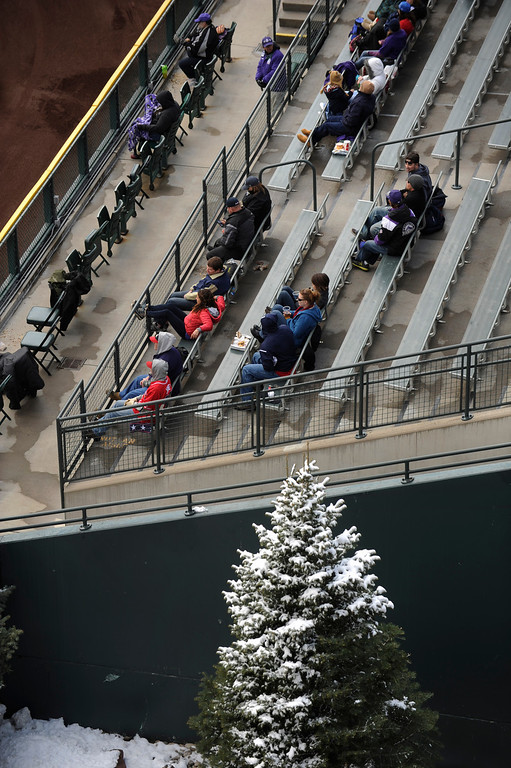 . DENVER, CO. - APRIL 23:  Fans in center field braved sitting on cold metal benches during the game Tuesday. The Atlanta Braves defeated the Colorado Rockies 4-3 at Coors Field Tuesday, April 23, 2013.  The first game of the doubleheader Tuesday was a make-up from Monday night\'s postponement due to weather.  Photo By Karl Gehring/The Denver Post