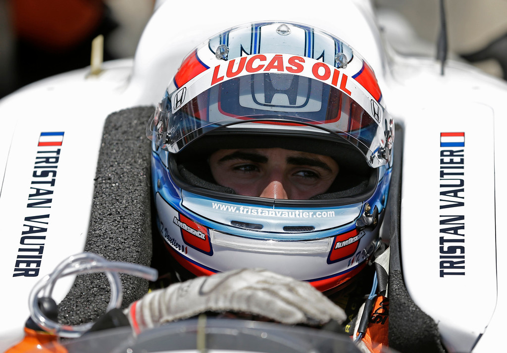 . Tristan Vautier, of France, talks with his crew as he sits in his car during practice for the Indianapolis 500 auto race at the Indianapolis Motor Speedway in Indianapolis, Wednesday, May 15, 2013. (AP Photo/Michael Conroy)