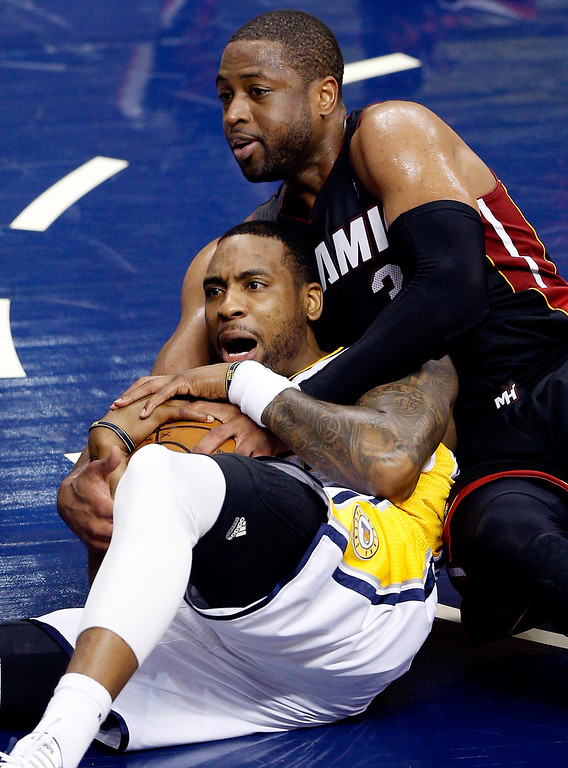 . INDIANAPOLIS, IN - MAY 28:  Rasual Butler #8 of the Indiana Pacers and Dwyane Wade #3 of the Miami Heat battle for a loose ball during Game Five of the Eastern Conference Finals of the 2014 NBA Playoffs at Bankers Life Fieldhouse on May 28, 2014 in Indianapolis, Indiana.  (Photo by Joe Robbins/Getty Images)