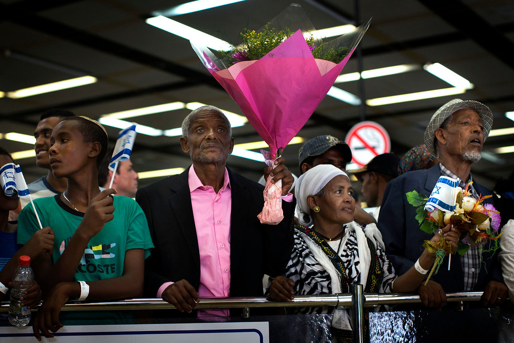 . Israeli Jewish elders, originally from Ethiopia, wait for the arrival of family members at the Ben Gurion airport near Tel Aviv, Israel, Wednesday, Aug. 28, 2013. Israeli authorities have completed what they say is the final large airlift of Ethiopian immigrants, culminating decades of efforts to bring in the remnants of an ancient community to the Jewish state. (AP/Bernat Armangue)