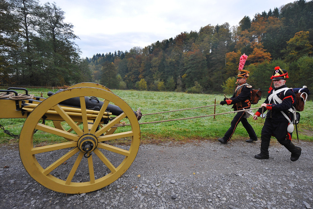 . Members of a local historical society dressed as soldiers of the 8th Artillery Regiment, 5th Division Dufour serving under Napoleon prepare to begin their four-day march to Leipzig on October 14, 2013 in Schellenberg, Germany. (Photo by Matthias Rietschel/Getty Images)