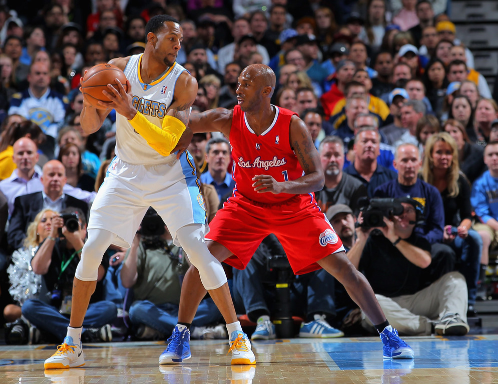 . DENVER, CO - MARCH 07:  Andre Iguodala #9 of the Denver Nuggets controls the ball against Chauncey Billups #1 of the Los Angeles Clippers at the Pepsi Center on March 7, 2013 in Denver, Colorado.   (Photo by Doug Pensinger/Getty Images)