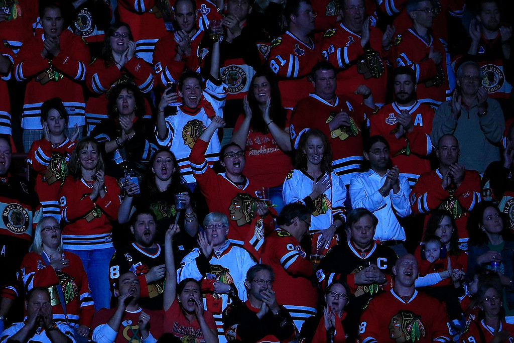 . CHICAGO, IL - JUNE 22:  Fans of the Chicago Blackhawks cheer during pregame against the Boston Bruins in Game Five of the 2013 NHL Stanley Cup Final at United Center on June 22, 2013 in Chicago, Illinois.  (Photo by Jamie Squire/Getty Images)