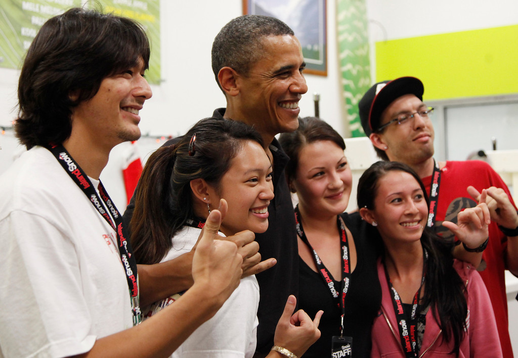 . President Barack Obama poses for a photos with employees at Island Snow at Kailua Beach Center while on vacation with the first family in Kailua, Hawaii, Monday, Dec. 27, 2010. (AP Photo/Carolyn Kaster)