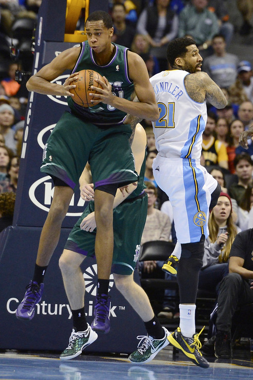 . DENVER, CO - FEBRUARY 5: John Henson Milwaukee Bucks (31) grabs a rebound away from Wilson Chandler Denver Nuggets (21) during the first half. The Denver Nuggets take on the Milwaukee Bucks in NBA action. (Photo By AAron Ontiveroz/The Denver Post)