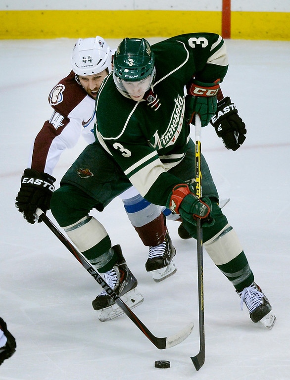 . Minnesota center Charlie Coyle (3) worked past Colorado defenseman Ryan Wilson (44) in the third period as the Minnesota Wild defeated the Colorado Avalanche 2-1 Thursday night April 24, 2014 at the Xcel Energy Center in St. Paul.   (Photo by Karl Gehring/The Denver Post)