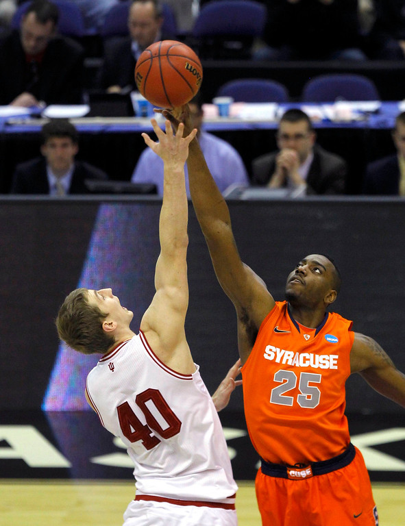. Indiana Hoosiers forward Cody Zeller (L) and Syracuse Orange forward Rakeem Christmas take the opening tip-off in their East Regional NCAA men\'s basketball game in Washington March 28, 2013. REUTERS/Gary Cameron