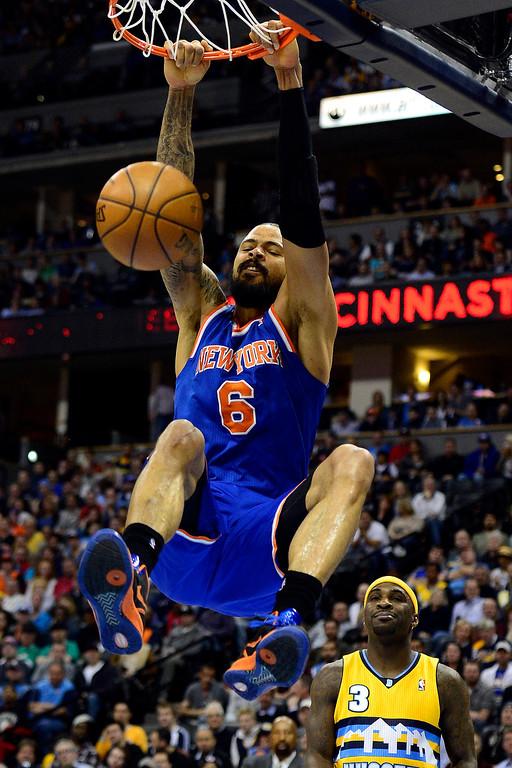 . DENVER, CO - MARCH 13: Tyson Chandler (6) of the New York Knicks dunks against the Denver Nuggets during the first half of action. The Denver Nuggets play the New York Knicks at the Pepsi Center. (Photo by AAron Ontiveroz/The Denver Post)