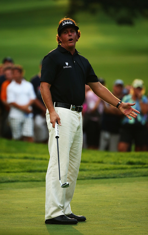 . ROCHESTER, NY - AUGUST 08:  Phil Mickelson of the United States reacts to a putt on the 17th green during the first round of the 95th PGA Championship on August 8, 2013 in Rochester, New York.  (Photo by Streeter Lecka/Getty Images)