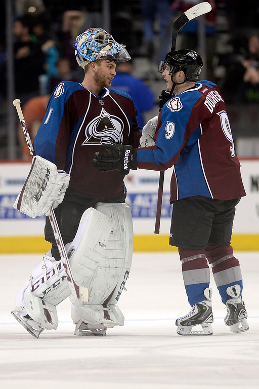 . Matt Duchene (9) of the Colorado Avalanche celebrates his game-winning goal with teammate Semyon Varlamov (1) of the Colorado Avalanche against the Winnipeg Jets during the Avs\' 3-2 win. (Photo by AAron Ontiveroz/The Denver Post)