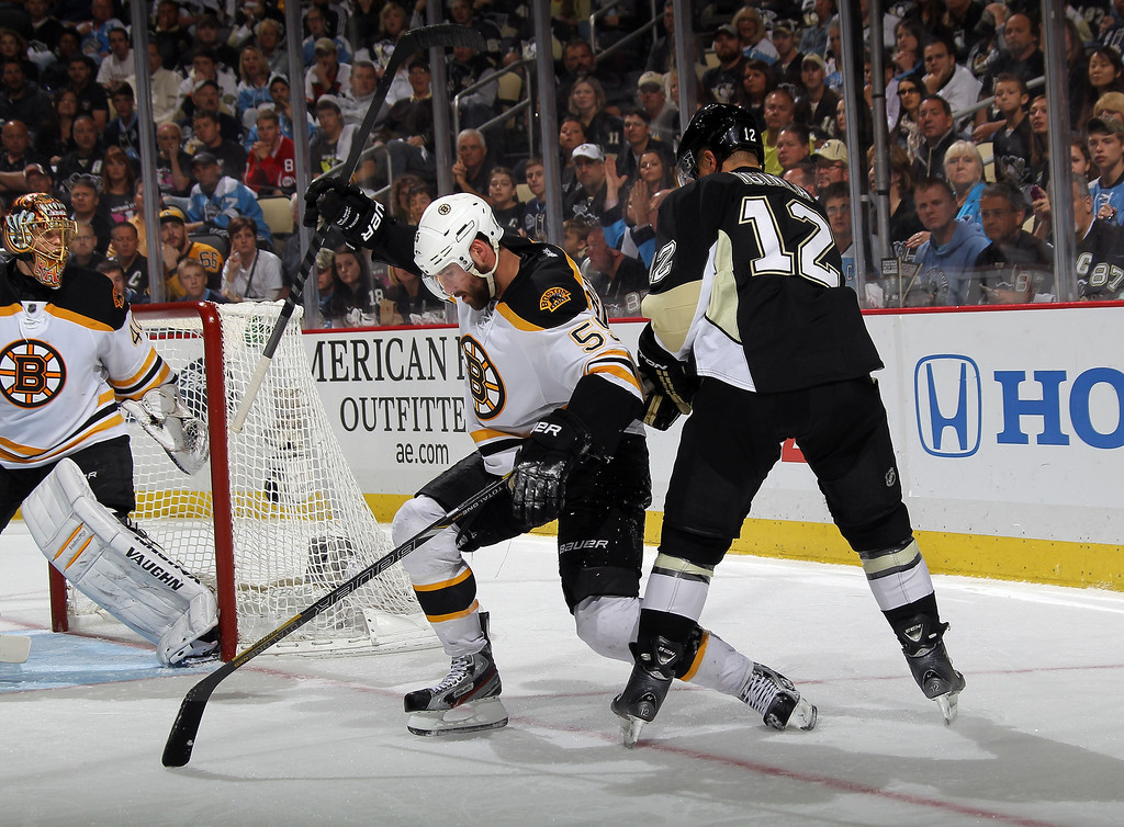 . Johnny Boychuk #55 of the Boston Bruins and Jarome Iginla #12 of the Pittsburgh Penguins get tangled up during Game Two of the Eastern Conference Final of the 2013 NHL Stanley Cup Playoffs at the Consol Energy Center on June 3, 2013 in Pittsburgh, Pennsylvania.  (Photo by Bruce Bennett/Getty Images)
