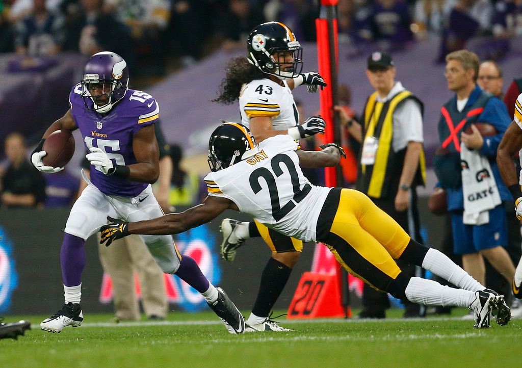 . Minnesota Vikings wide receiver Greg Jennings avoids a tackle from Pittsburgh Steelers cornerback William Gay (22) as he runs for 70-yard touchdown after a pass from quarterback Matt Cassel during their NFL football game against the Pittsburgh Steelers at Wembley Stadium, London, Sunday,Sept. 29, 2013.  (AP Photo/Matt Dunham)