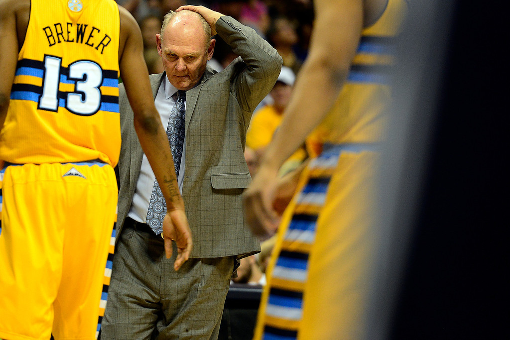 . Denver Nuggets head coach George Karl rubs his head against the Toronto Raptors during the second half of the Nuggets\' 113-110 win at the Pepsi Center on Monday, December 3, 2012. AAron Ontiveroz, The Denver Post