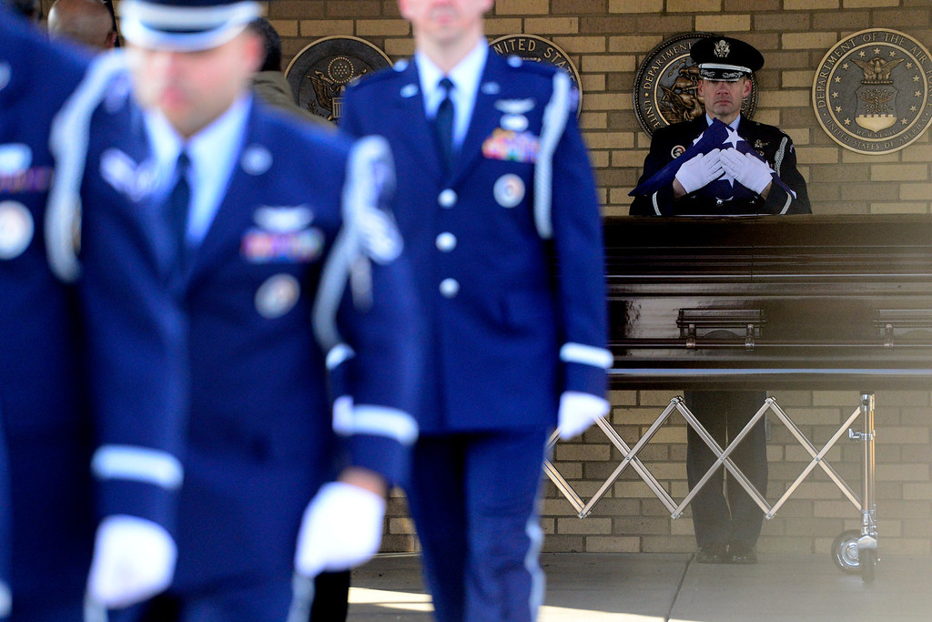 . The flag is presented during the funeral service for Colonel Fitzroy Newsum at Fort Logan National Cemetery on Monday, January 14, 2013. Newsum, who was 94, served as a Tuskegee Airman during his military service. AAron Ontiveroz, The Denver Post