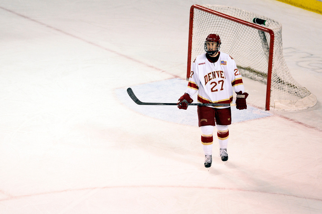. DENVER, CO - MARCH 17: Quentin Shore (27) of the University of Denver Pioneers reacts to losing to the Colorado College Tigers after the third period of action. The University of Denver loses 4-3 to Colorado College during the WCHA playoffs at Magness Arena. (Photo by AAron Ontiveroz/The Denver Post)